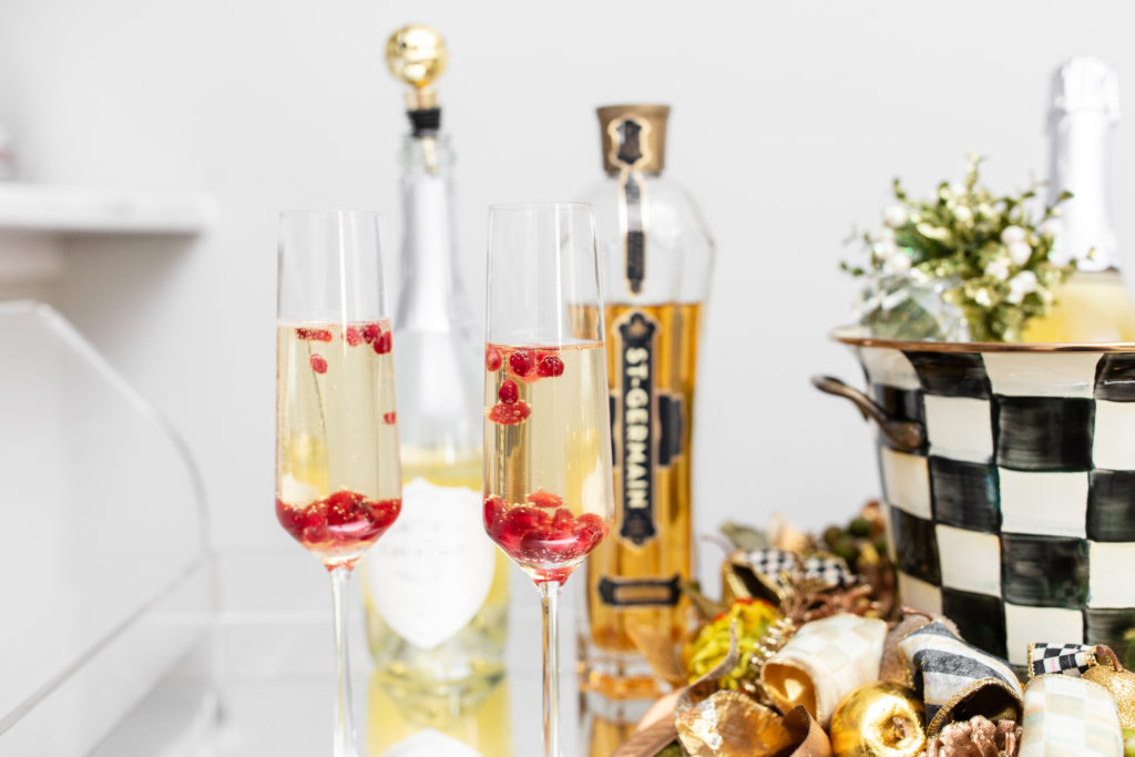 st. germain, pomegranate, spritzer, champagne cocktail, hostess, holiday drinks, le grand courtage